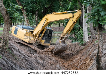 excavators digging canal. - stock photo