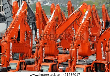 excavators import export in the russian port Vladivostok - stock photo