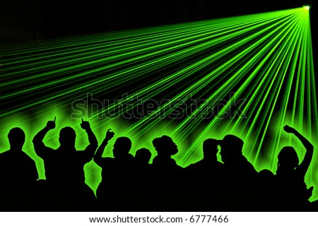 Excelent green laser party at the club with dance silhouette people. - stock photo