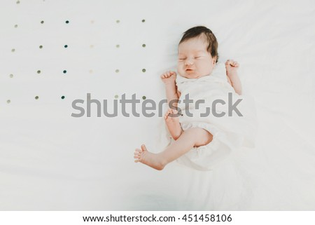 excellent active baby lying on the bed
