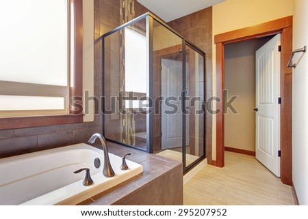 Excellent bathroom with full  bath and shower, including a large window. - stock photo