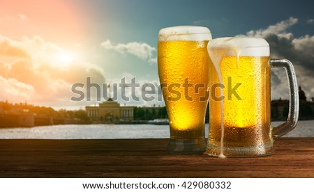 excellent beer on a city background - stock photo