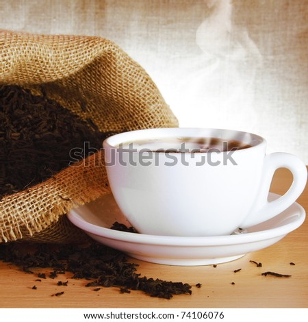 Excellent Black Tea and Bag with Steam - stock photo