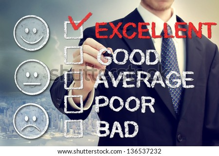 Excellent on customer survey - Business man with smiley faces - stock photo