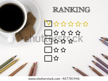 Excellent Ranking. White desk with a pencil and a cup of coffee. - stock photo