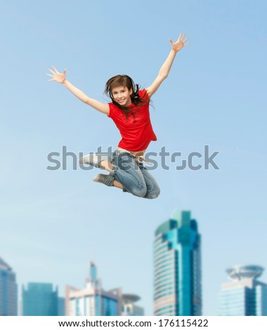 excercise and fitness concept - happy girl jumping in the air - stock photo
