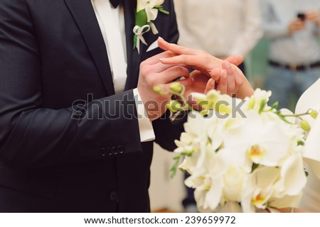 exchange of wedding rings at ceremony - stock photo