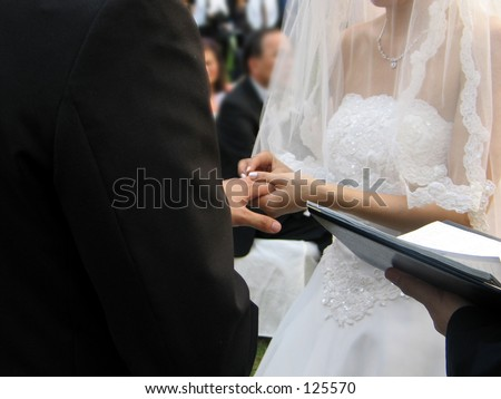 exchanging wedding rings - stock photo