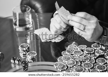 Excitable guy playing poker - stock photo