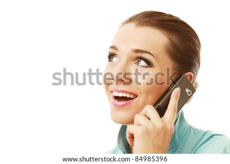 Excite young lady on phone looking at copyspace isolated on white - stock photo