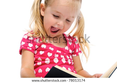 excited adorable girl is happy while reading a book, isolated on white