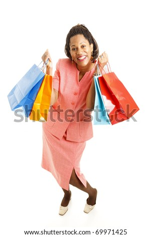 Excited african-american woman, holding shopping bags.  Full body isolated on white.