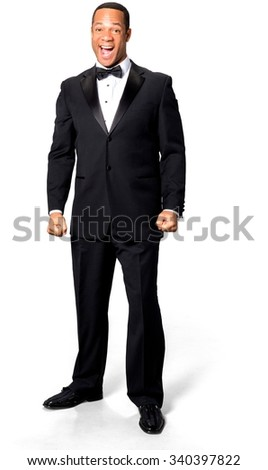 Excited African man with short black hair in evening outfit celebrating - Isolated