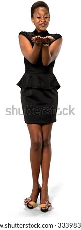 Excited African young woman with short dark brown hair in evening outfit holding invisible object - Isolated