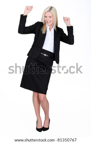 Excited blond businesswoman - stock photo
