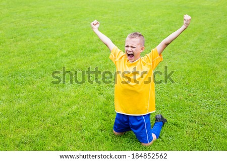 Excited boy football player after goal scored.