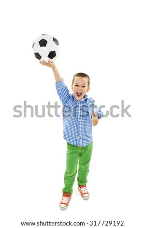 Excited boy is holding a football ball made of genuine leather. Isolated on a white background. Soccer ball - stock photo