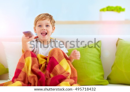 excited boy, kid watching tv at home