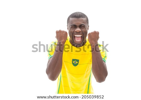 Excited brazilian football fan cheering on white background