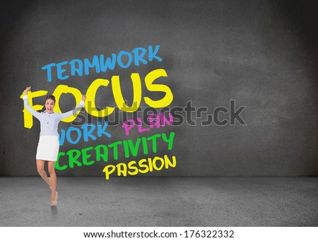 Excited brunette businesswoman jumping and cheering against buzz words in room - stock photo