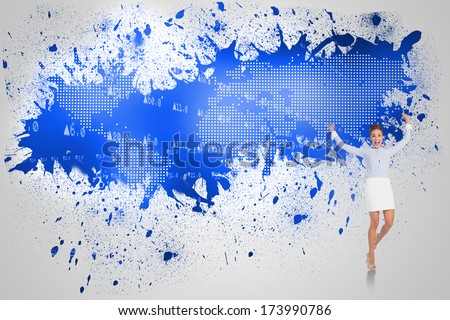 Excited brunette businesswoman jumping and cheering against splash on wall revealing blue world map - stock photo