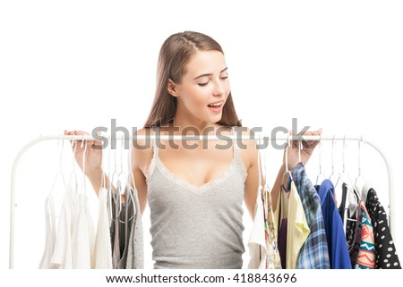 Excited brunette looking down at clothes