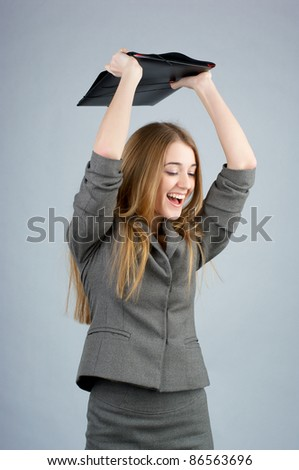 Excited businesswoman with folder over her head - stock photo