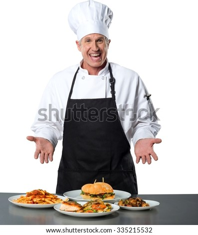 Excited Caucasian Chef in uniform with hands open presenting a different food in front of him - Isolated