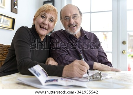 Excited Caucasian elderly men with short red hair