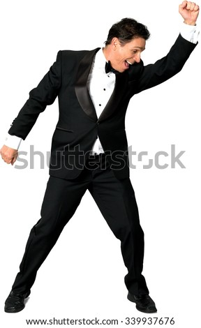 Excited Caucasian man with short black hair in evening outfit dancing - Isolated - stock photo