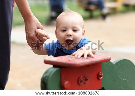 Excited child is playing at outdoor playground