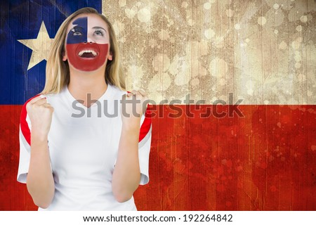 Excited chile fan in face paint cheering against chile flag in grunge effect - stock photo