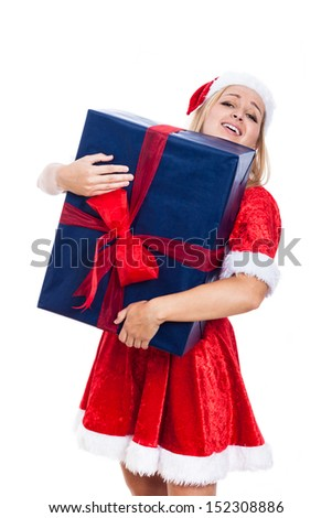 Excited Christmas woman carrying huge present, isolated on white background. - stock photo
