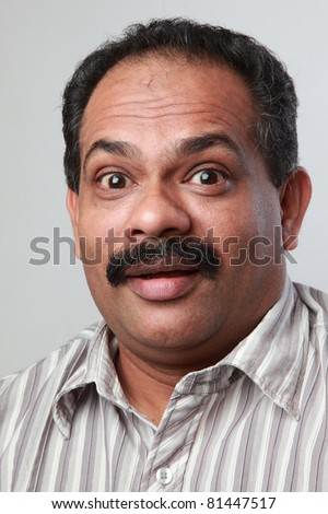 Excited face of a middle aged Indian male - stock photo