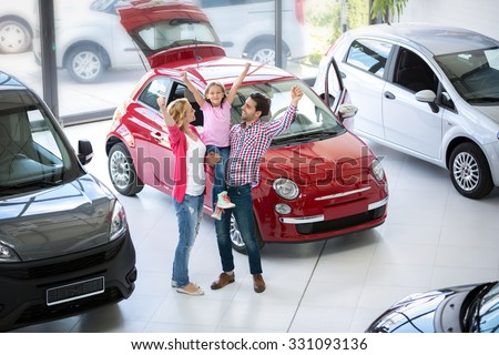 excited family buying a new car in the car dealership  saloon - stock photo
