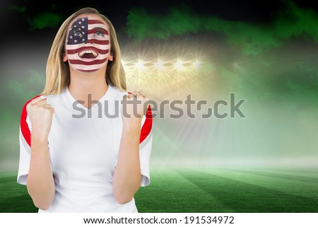 Excited fan in usa face paint cheering against football pitch under green sky and spotlights - stock photo