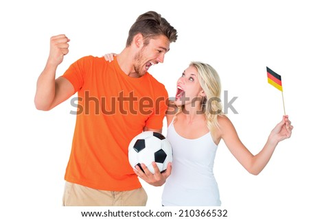 Excited football fan couple cheering on white background - stock photo