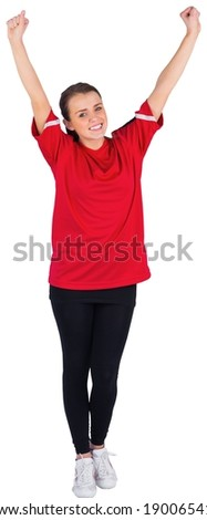 Excited football fan in red cheering on white background