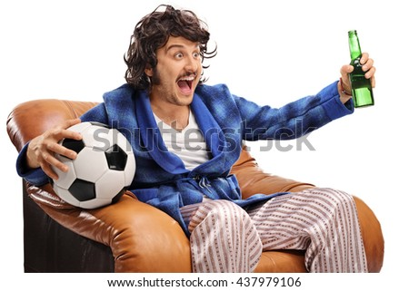 Excited football fan watching a game on TV and drinking beer isolated on white background - stock photo