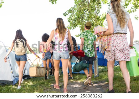 Excited friends arriving at music festival on a summers day - stock photo