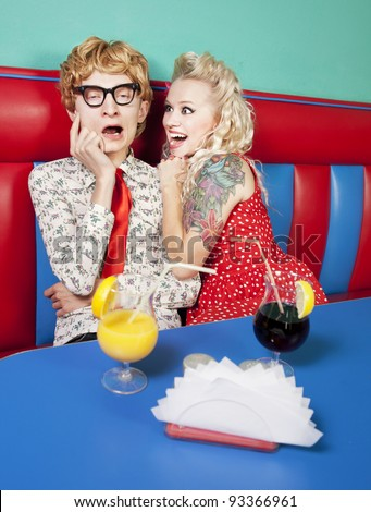 Excited girl with a bored nerdy guy - stock photo