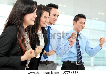 Excited group of business people celebrating success - stock photo