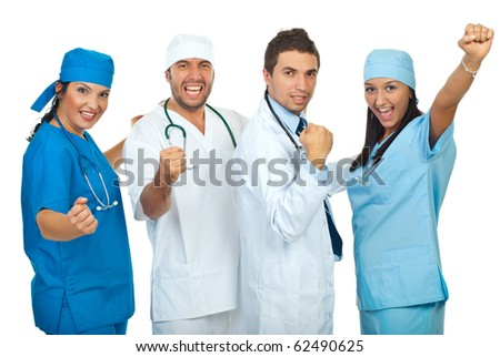 Excited group of doctors with achievements raising hands isolated on white background - stock photo
