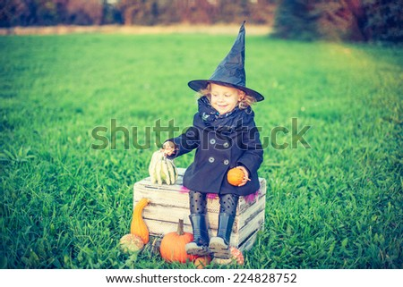 Excited Halloween witch - stock photo