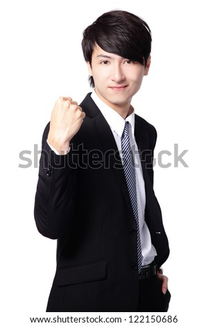 Excited handsome business man with arms raised and showing his fist isolated on white background, mode is a asian people - stock photo