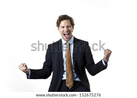 Excited happy businessman shouting in triumph - stock photo