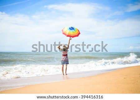 Excited happy female having fun on beach walk on sunny background outdoors