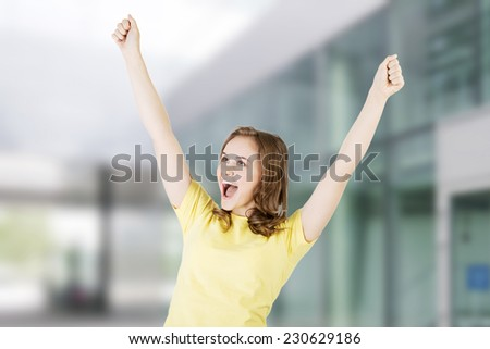 Excited happy success young woman with fists up - stock photo
