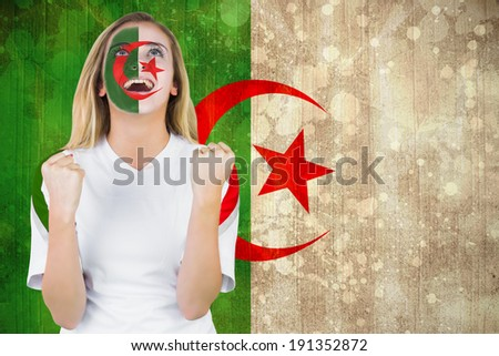 Excited iran fan in face paint cheering against algeria flag in grunge effect - stock photo