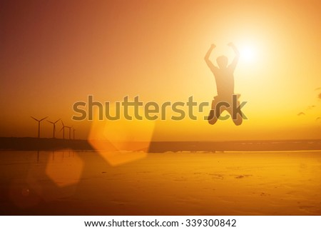 Excited Jump as success concept - stock photo